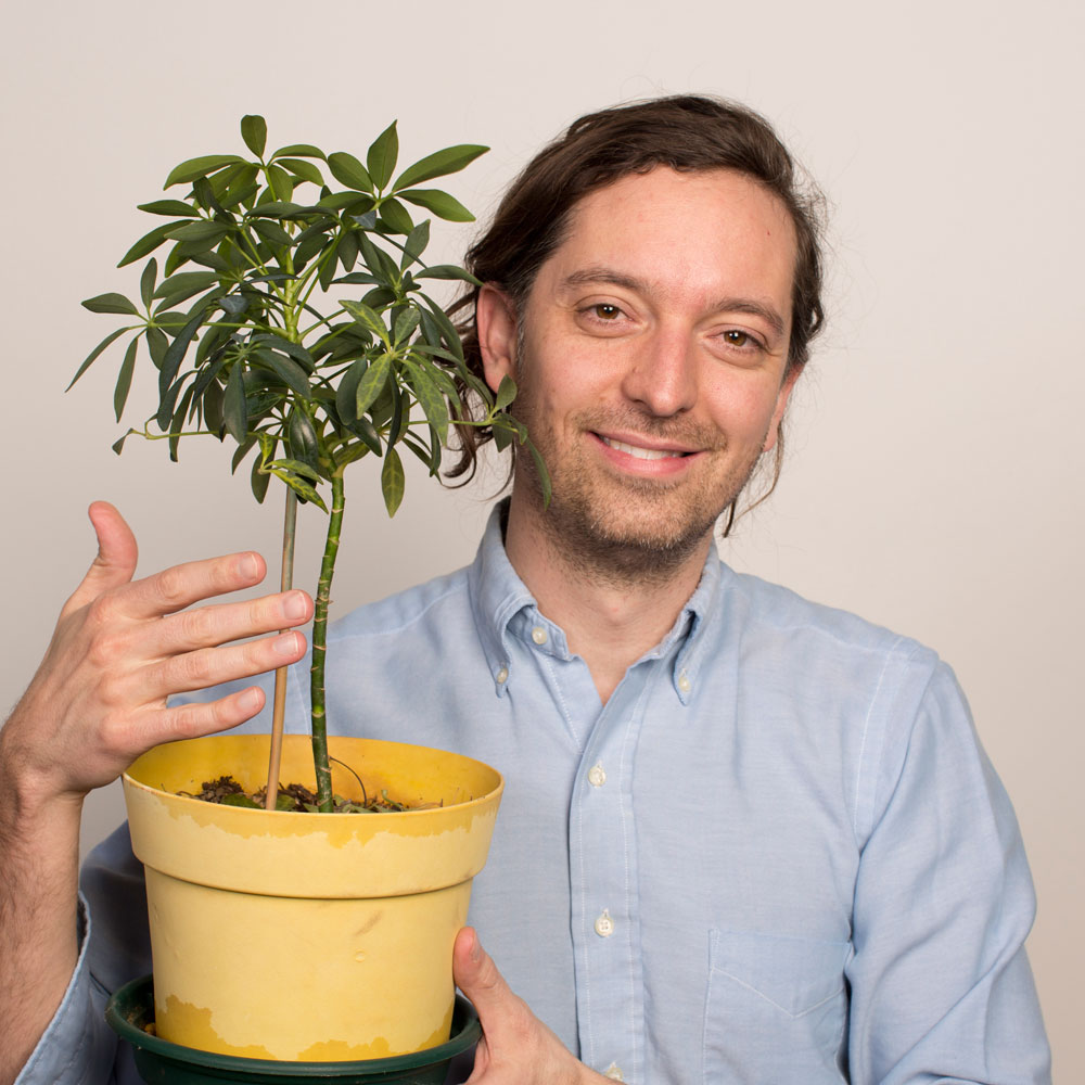 Andrew holding a plant